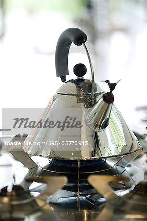Tea kettle heating on gas stove