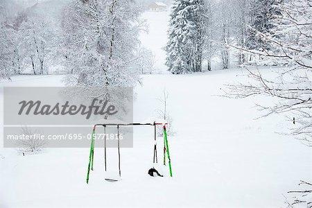 Snow-covered swingset
