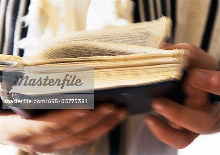 Jewish man's hands holding Torah, close-up