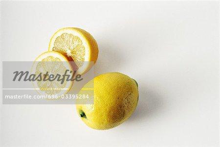 Whole and sliced lemons, close-up