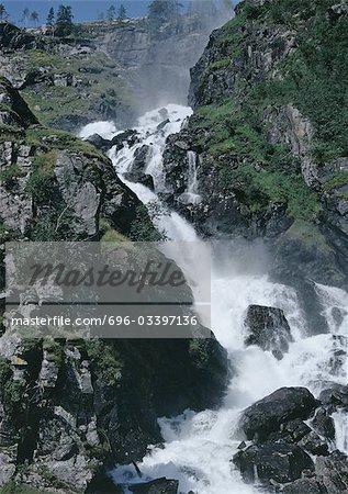 Waterfall in rocky landscape