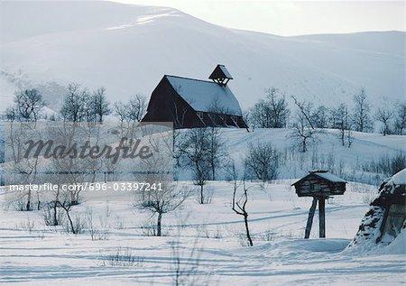Sweden Barn In Snowy Landscape
