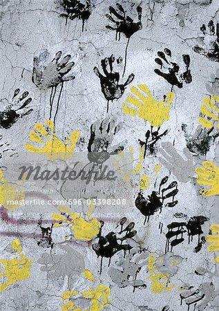 Yellow, black, gray hand print on wall