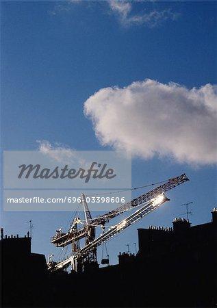 Cranes above rooftops