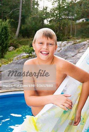 Happy boy beside pool