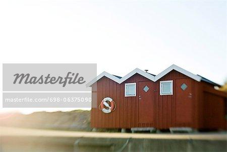 Beach huts against clear sky