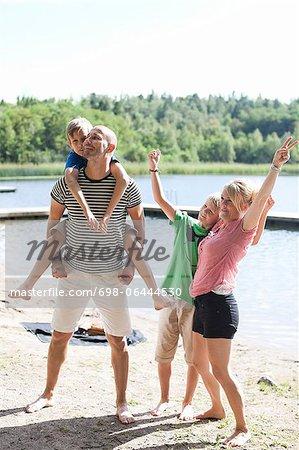 Happy Caucasian family enjoying together at beach