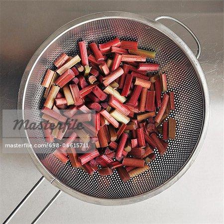 Pieces of Rhubarbs in colander