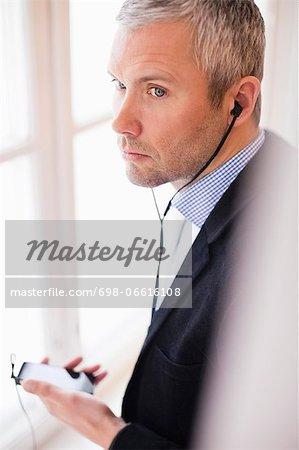 Mature businessman talking through hands-free device