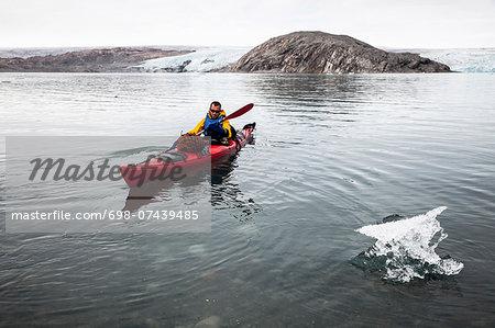 Mature man kayaking on sea