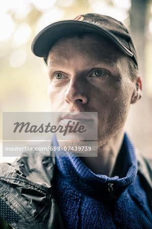 Thoughtful man wearing cap looking away outdoors