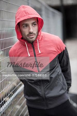 Sporty man in hooded jacket