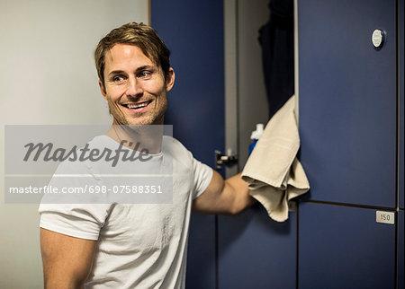 Happy man locker room at health club