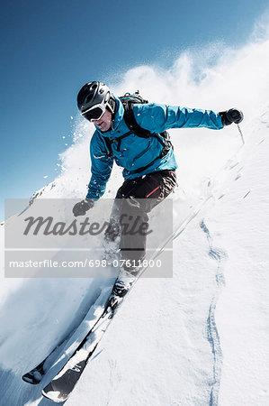 Full length of man skiing on mountain slope