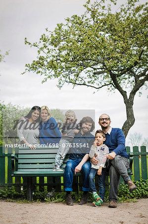 Portrait of homosexual families at park