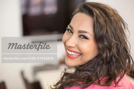 Portrait of happy businesswoman in creative office