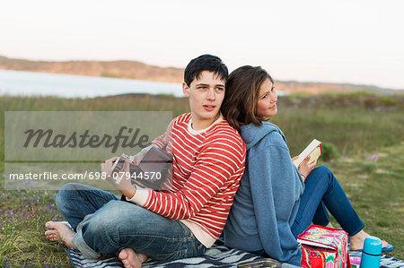 Couple enjoying picnic on field
