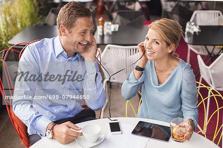 Happy business people taking break in cafe