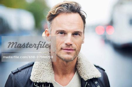 Portrait of confident mature man standing on street