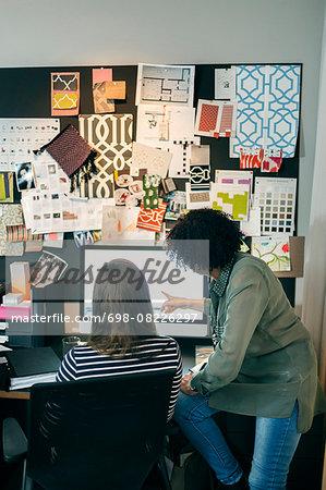 Businesswomen working on computer in office