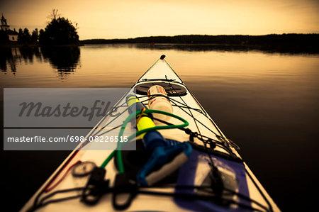 Cropped image of kayak on lake during sunset