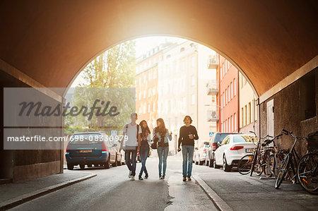 Teenagers walking in tunnel