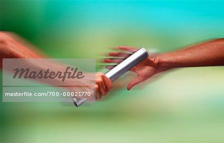 Close-Up of Hands Passing Baton