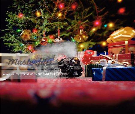 toy train set under christmas tree stock photo - Train Under Christmas Tree