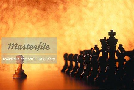 White Pawn Facing Black Chess Pieces