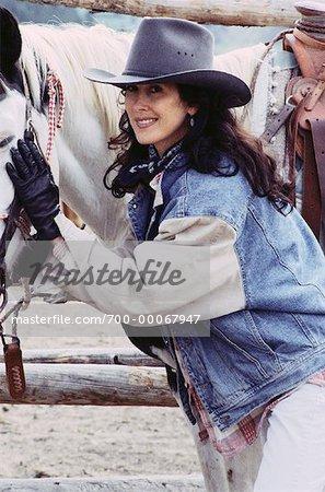 Portrait of Woman Wearing Cowboy Hat 0aec41cca255
