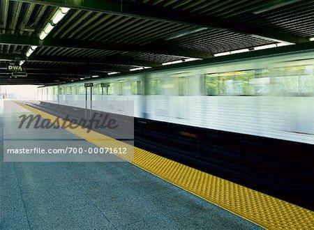 Subway Station Interior with Blurred Train Toronto, Ontario, Canada