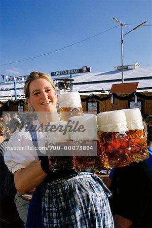 Portrait of Oktoberfest Girl Holding Mugs of Beer Munich, Germany