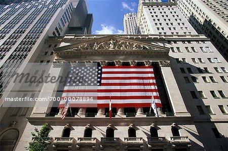 New York Stock Exchange with American Flag New York, New York, USA