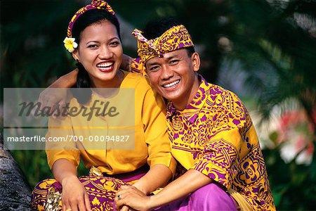 Couple In Traditional Dress Kuta Beach Bali Indonesia Stock Photo