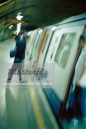 Person Boarding Subway London, England