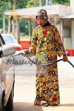 gas station attendant langkawi island malaysia stock photo