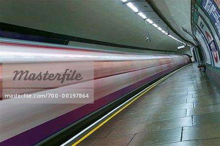 Subway Moving by Deserted Platform London, England