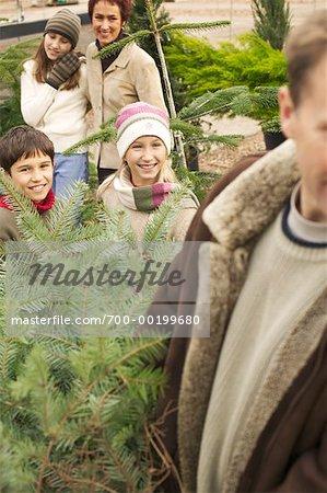 Family Buying Christmas Tree