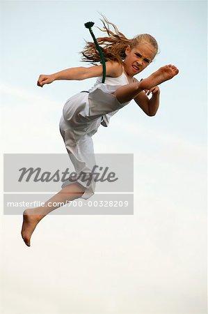 Girl doing a Karate Kick