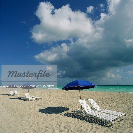 Beach Chairs And Parasol On Beach Miami Beach, Miami, Florida USA   Stock  Photo