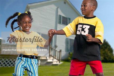 Boy and Girl Playing in Yard
