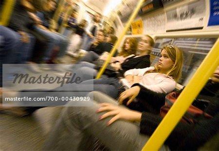 Commuters Sitting in Train, London, England