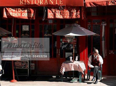 Waiter Smoking on Patio, Little Italy, New York, New York