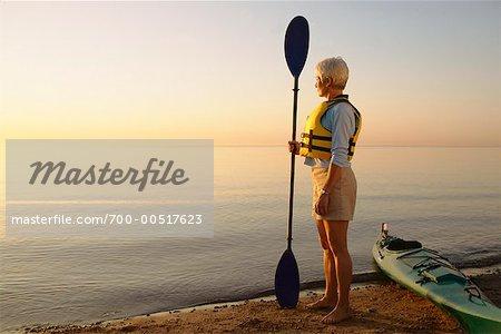 Kayaker Watching Sunset