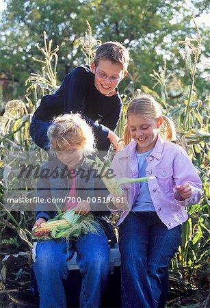 Children Shucking Corn on the Cob