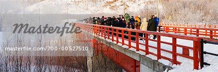 Photographers Looking over Edge Of Bridge, Hokkaido, Japan