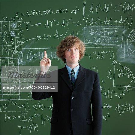 Portrait of Man in Front of Chalkboard