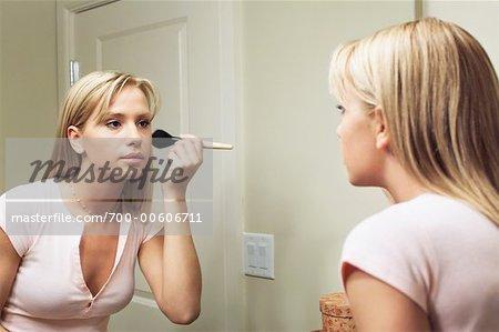 Young Woman Applying Make-Up