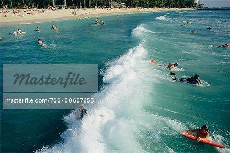 People Surfing In The Pacific Ocean Waikiki Beach Oahu Hawaii USA