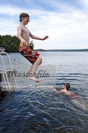 Two Brothers Swimming, Lake Rosseau, Muskoka, Ontario, Canada